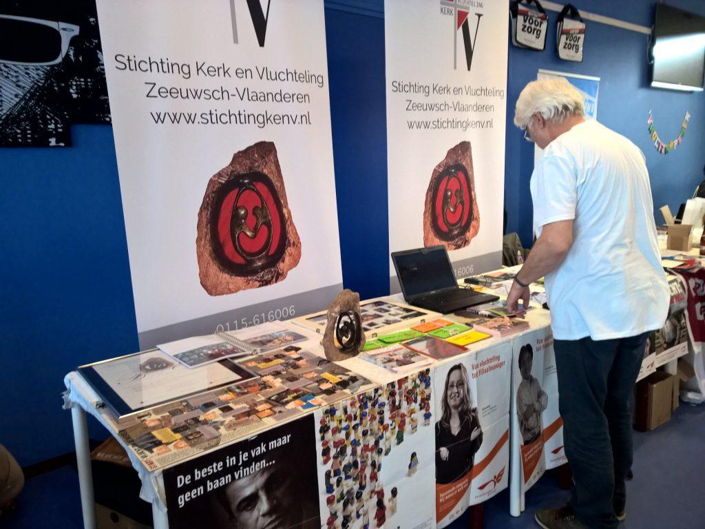 Welzijnsmarkt tafel Kerk en Vluchteling